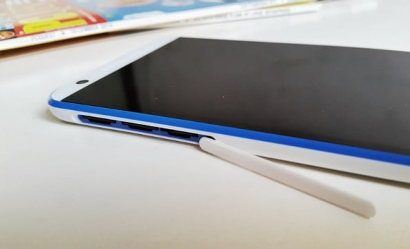 The micro SD and SIM card slots are protected by a large rubberized flap on the left edge